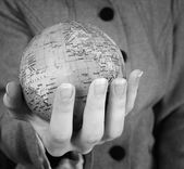 Globe in a girl's hands — Stock Photo
