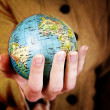 Stock Photo: Globe in girl's hands
