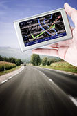 Gps in een man hand — Stockfoto