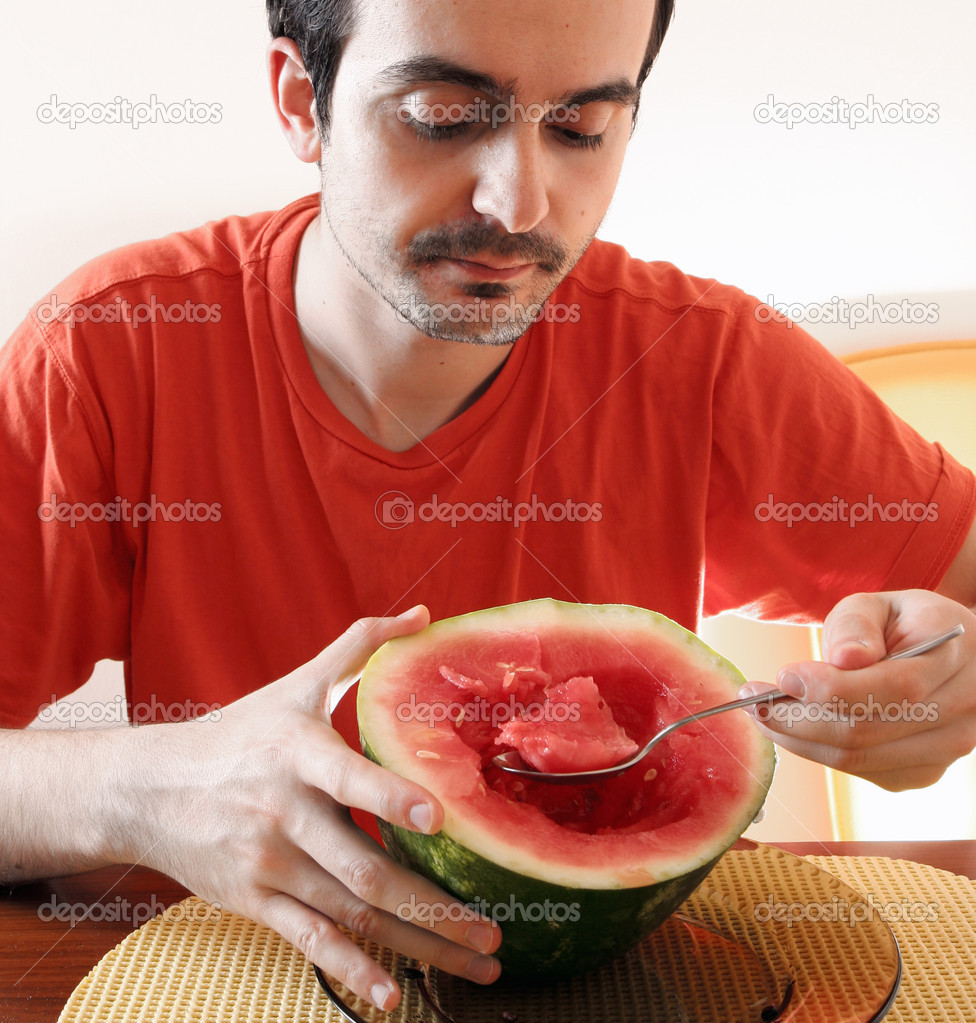 Man eating a slice of watermelon. — Stock Photo #3579531