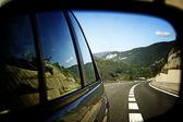 Car mirror reflection — Stock Photo