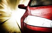 κόκκινο αυτοκίνητο άθλημα - μπροστινή πλευρά — Φωτογραφία Αρχείου