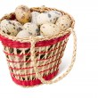 Quail eggs in a straw basket — Stock Photo #2772670