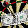 Darts target and dollar in bull's-eye — Stock Photo