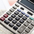 Calculator and diagram — Stock Photo
