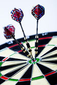 Darts in bull's-eye — Stock Photo