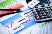 Calculator and diagram, Finance series — Stock Photo