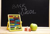 Back to school, inscription on blackboard — Stock Photo