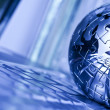 Globe and computer — Stock Photo