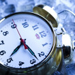 Stock Photo: Classical Clock among ice cubes