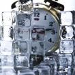 Classical Clock among ice cubes — Stock Photo