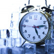 Alarm colck among ice cubes — Stock Photo