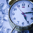 Clock and Ice cubes — Stock Photo