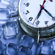 Ice cubes & Alarm clock — Stock Photo