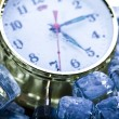 The time has come - alarm clock and ice — Stock Photo