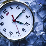 Ice cubes & Alarm clock — Stock Photo #3821679