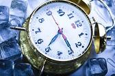Ice cubes & Alarm clock — Stock Photo