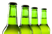 Bottles of beer against a white background — Stok fotoğraf
