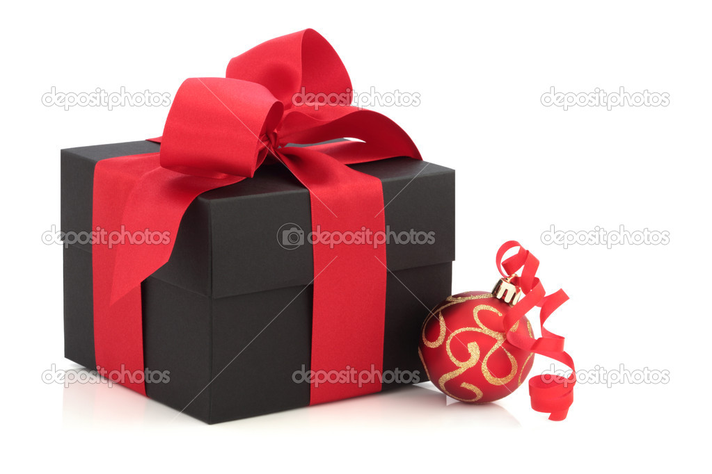 Christmas gift box tied with a satin bow, with red and gold sparkling bauble and ribbon, isolated over white background.  Stock Photo #3516263