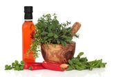 Chillies, Oil and Herb Leaves — Stock Photo