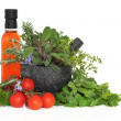 Stock Photo: Chili Oil, Herb Leaves and Tomatoes