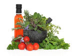 Chili Oil, Herb Leaves and Tomatoes — Stock Photo