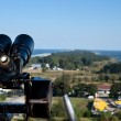 Binoculars and the aerial view — Stock Photo