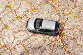 Car on the map — Stock Photo