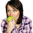 Girl eating an apple — Stock fotografie