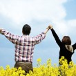 Young couple in a rape field — Stock Photo