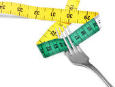 Fork and measuring tape — Stockfoto