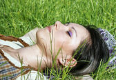 Young female lying on the grass — Stock Photo