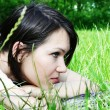 Young female lying on the grass — Stock Photo #3262556