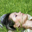 Young female lying on the grass — Stock Photo #3455353
