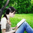 Young woman reading a novel — Stock Photo