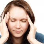 Woman with a headache — Stock Photo #3732898