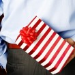 Stock Photo: Businessman hiding a gift