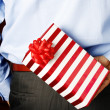 Foto Stock: Businessman hiding a gift