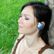 Young woman listening music — Stock Photo #3747255
