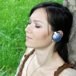 Royalty-Free Stock Photo: Young woman listening music