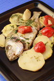 Fish with potatoes and tomatoes — Stock Photo