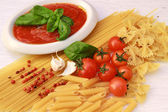 Pasta with tomatoes sauce and basil — Stock Photo