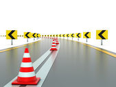 Road with signs and traffic cones — 图库照片