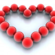 Red balls in heart shape — Stock Photo