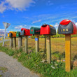 Colorful row of post boxes - Stock Photo