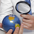 Stock Photo: Businessmholding globe