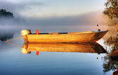 A boat in mist — Stock Photo