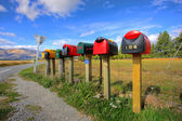 Colorful row of post boxes — Stock Photo