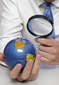 Businessman holding globe — Stock Photo