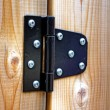 Metal hinge on wood — Stock Photo